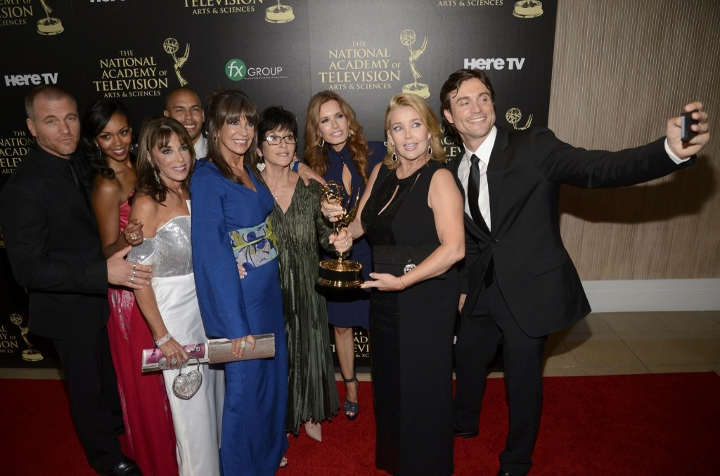 """Cast and crew of """"The Young and the Restless"""" backstage with the award for outstanding drama series at the Daytime Emmy Awards. REUTERS/Phil McCarten"""