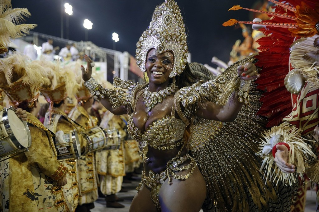 A dancer from the Unidos da Vila Maria samba school performs during a carnival parade in Sao Paulo. AP Photo/Andre Penner