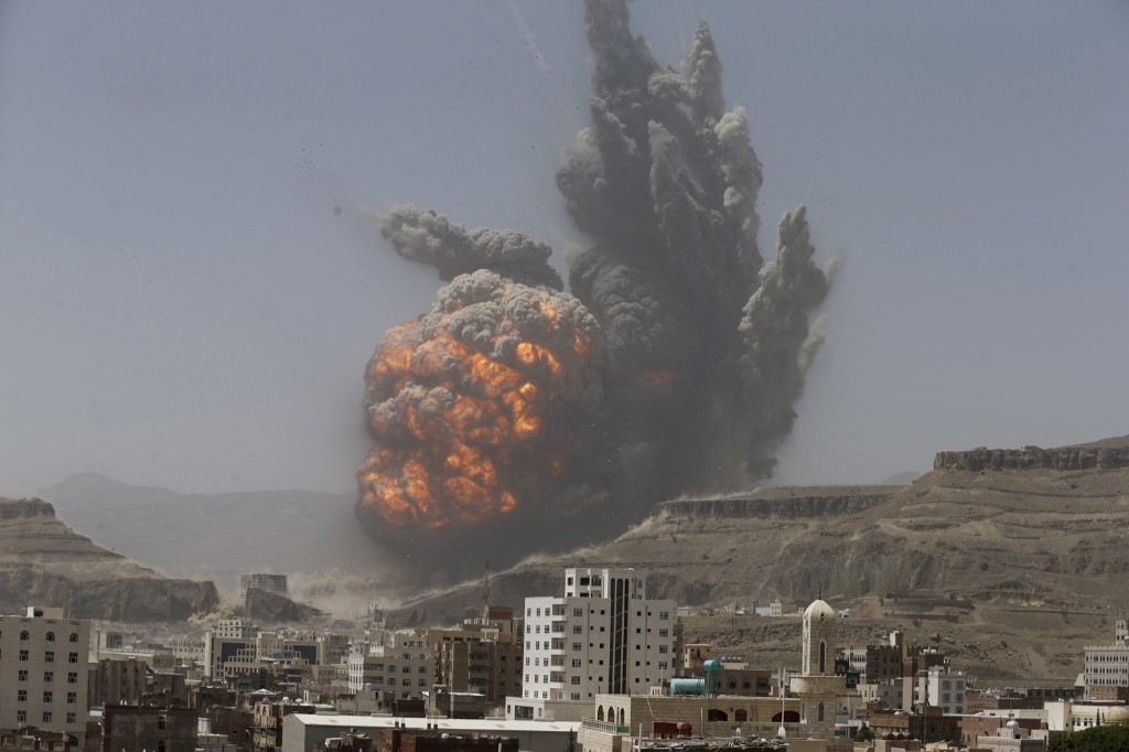 Smoke rises from an air strike on a weapons depot near Yemen's capital of Sanaa. REUTERS/Khaled Abdullah