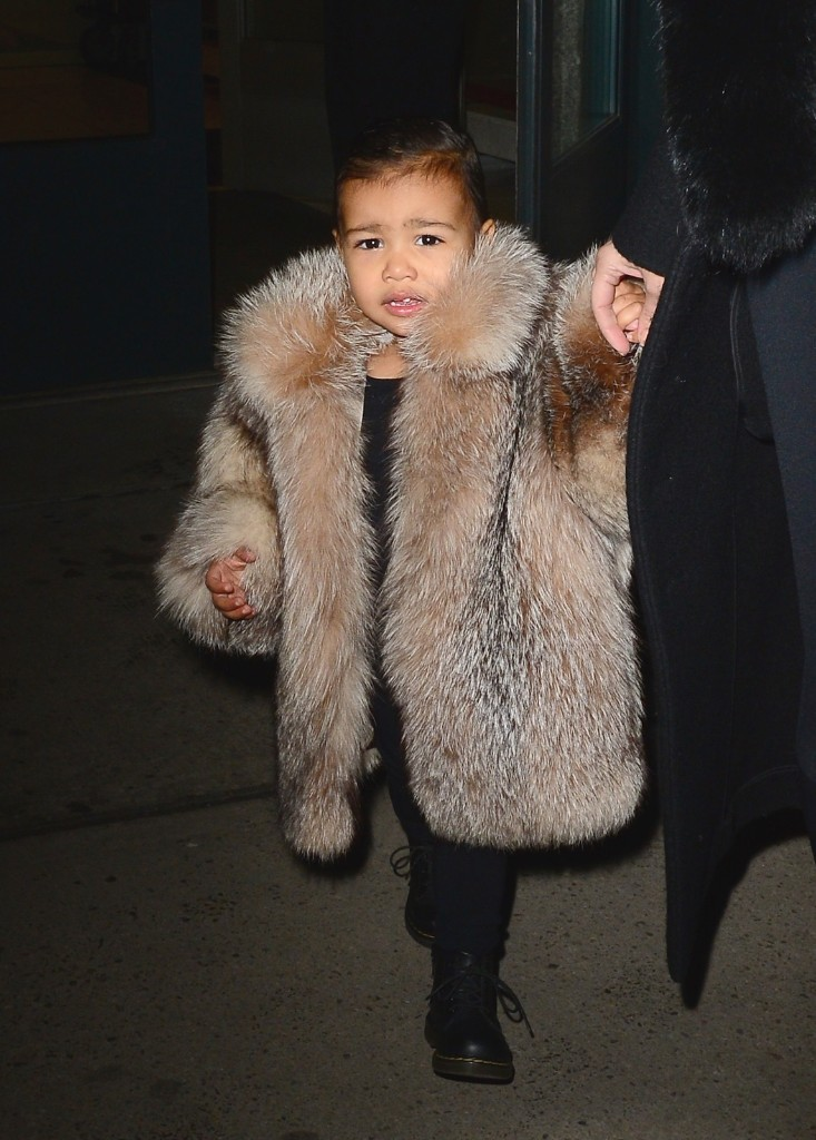 Kim Kardashian and Kanye West's daughter North West is seen in Soho Wednesday in New York. Raymond Hall/GC Images