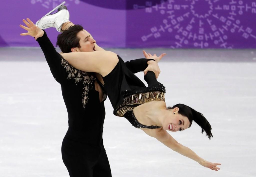 Tessa Virtue and Scott Moir of Canada during the team event ice dance. REUTERS/Damir Sagolj