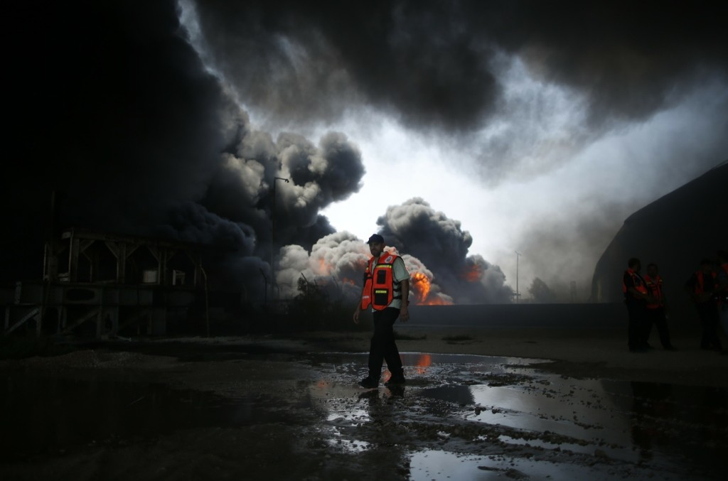 A Palestinian firefighter outside Gaza's main power plant after it was hit by shells. REUTERS/Mohammed Salem