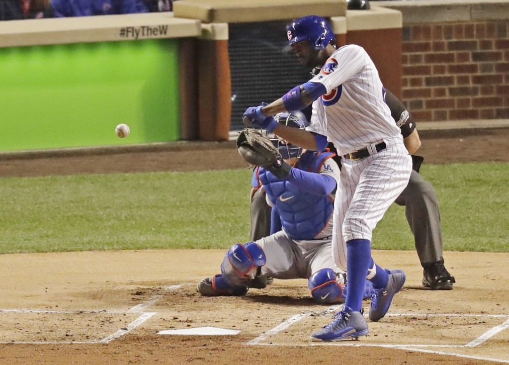 Cubs Dexter Fowler leads off with a double in the first inning. AP Photo/Charles Rex Arbogast