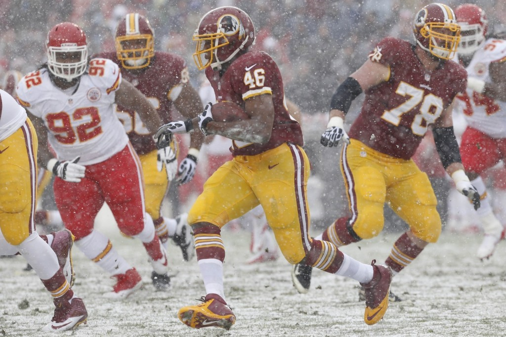 Redskins running back Alfred Morris plowing through the snow in DC against the Chiefs. Geoff Burke-USA TODAY Sports