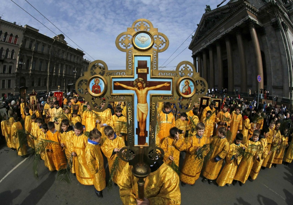 Children take part in a religious procession to mark Palm Sunday in St. Petersburg. REUTERS/Alexander Demianchuk