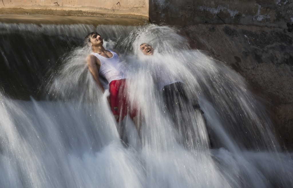 Pakistani men bathe in a stream to beat the heat on the outskirts of Islamabad. AP Photo/B.K. Bangash
