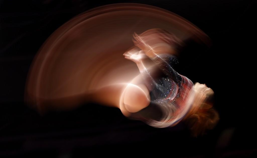 France's Anne Kuhm performs on the beam during World Gymnastics Championships in Glasgow. AP Photo/Matthias Schrader