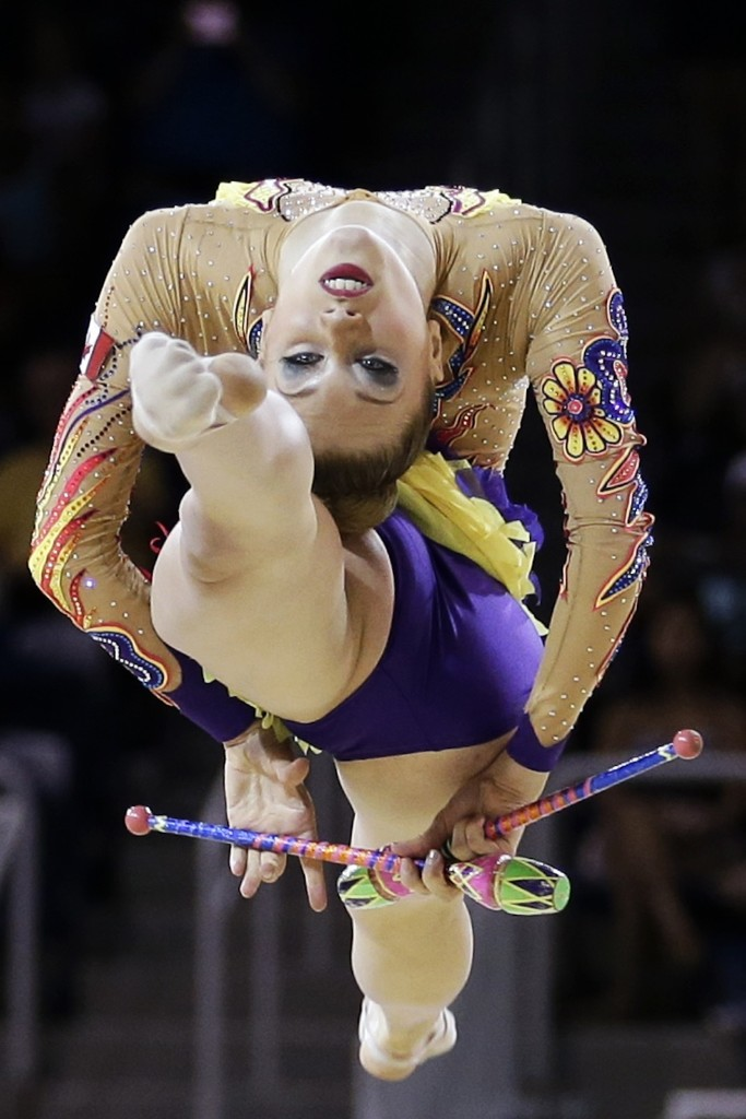 Canada's Carmen Whelan during the rhythmic gymnastics competition at the Pan Am Games. AP Photo/Gregory Bull