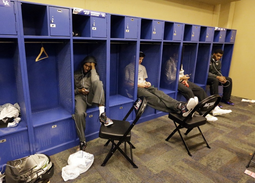 Kentucky players sit in lockers after being upset by Wisconsin, 71-64, in Indianapolis. AP Photo/David J. Phillip