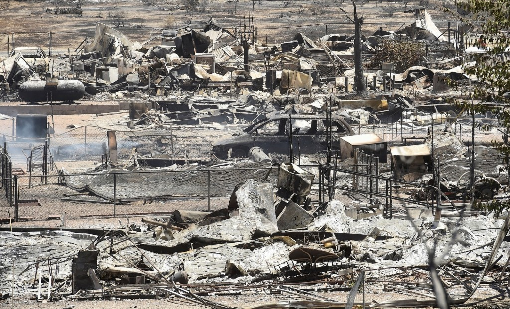 The remains of scorched homes line a street after the Erskine Fire burned through South Lake, Calif. REUTERS/Noah Berger