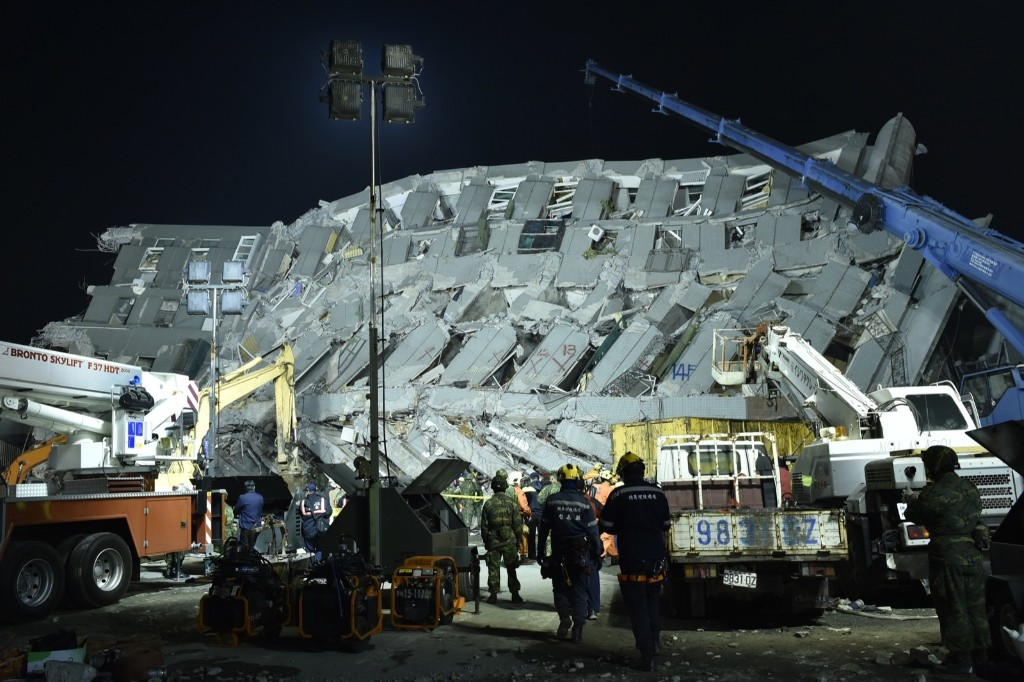 Rescue personnel work at the site of a collapsed building in the southern Taiwanese city of Tainan. SAM YEH/AFP/Getty Images