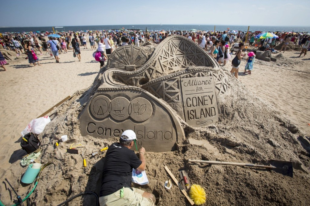A man works on his creation during the Coney Island Sand Sculpting Contest. REUTERS/Andrew Kelly