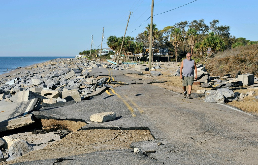 Mike Lester walks along the washed out road in front of his home on the Gulf of Mexico in the aftermath of Hurricane Michael at Alligator Point in Franklin County, Florida, U.S., October 13, 2018. REUTERS/Steve Nesius