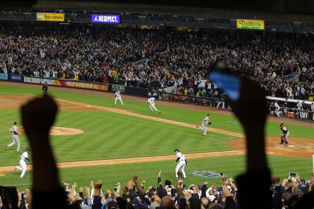 The Stadium erupts after Derek Jeter wins the game for the Yankees. Brad Penner-USA TODAY Sports