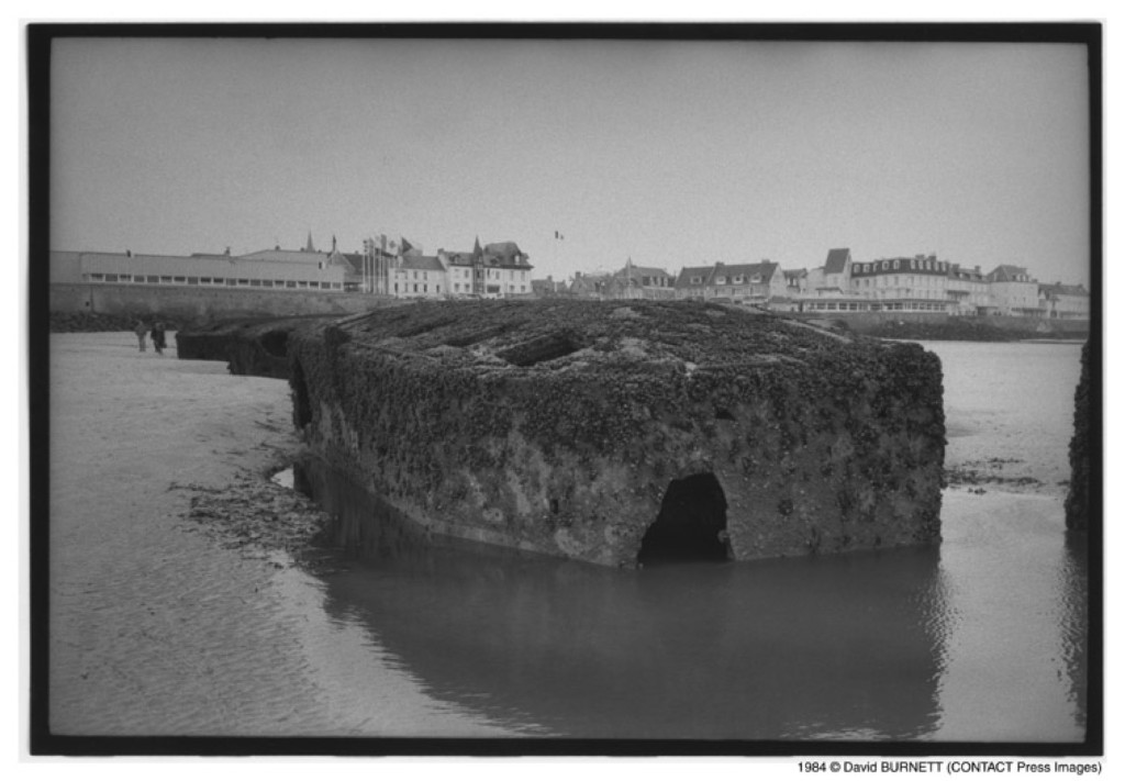 Remains of Port Mulberry, an artificial harbor imported by the British at Arromanches, Normandy, 1994. David Burnett/Contact Press Images