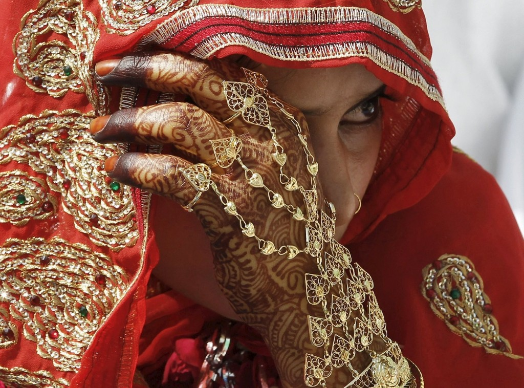 A Muslim bride waits for the start of a mass marriage ceremony in the western Indian city of Ahmedabad. REUTERS/Amit Dave