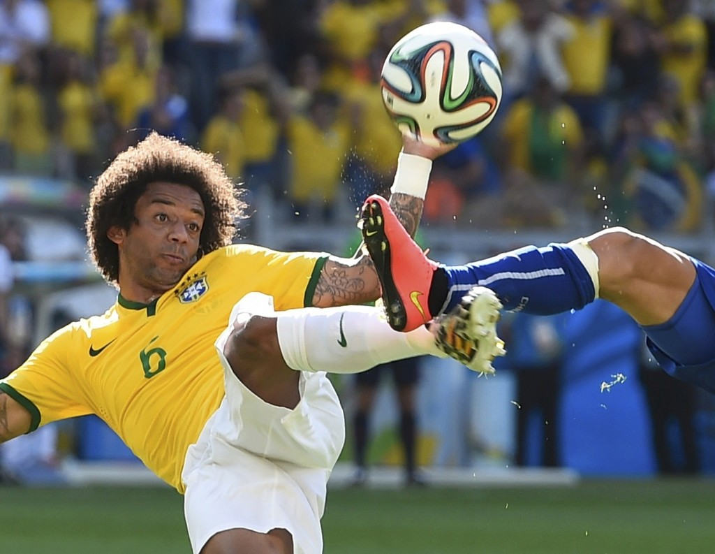 Brazil's Marcelo fights for ball with Chile's Charles Aranguiz. REUTERS/Dylan Martinez