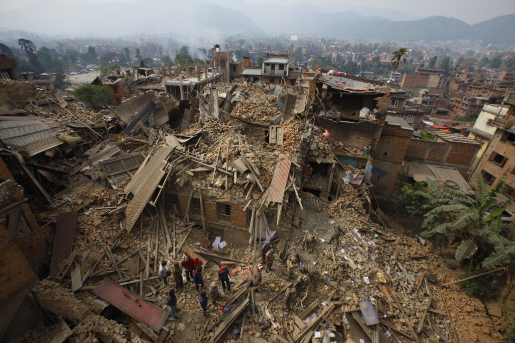 Rescue workers remove debris as they search for victims of earthquake in Bhaktapur. AP Photo/Niranjan Shrestha