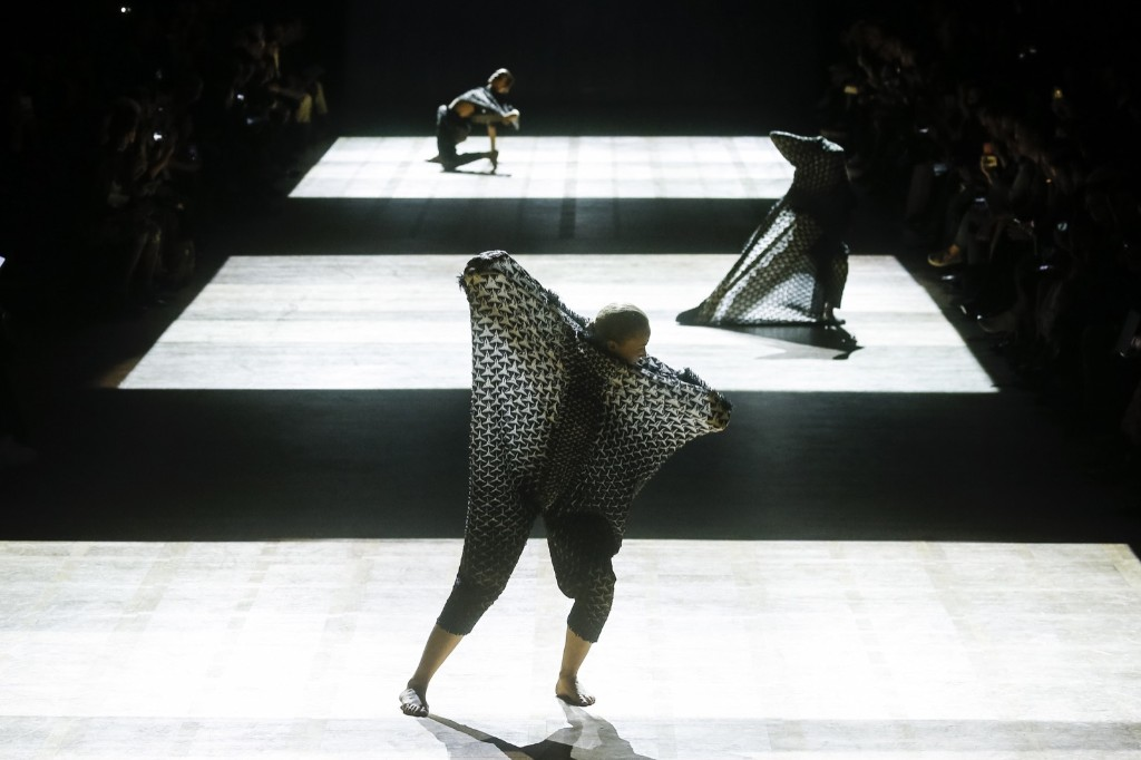 Dancers performs on the runway during the Issey Miyake show at the Grand Palais. Richard Bord/WireImage
