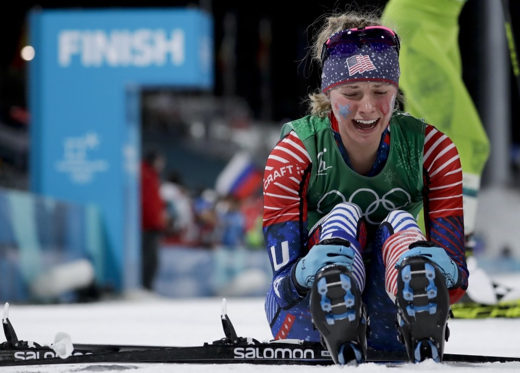Jessica Diggins of the United States celebrates after winning the gold medal in the women's team sprint freestyle cross-country skiing. AP Photo/Matthias Schrader