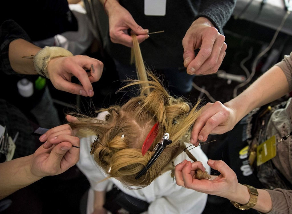 A model gets her hair done before the Desigual Fall/Winter 2015 collection during New York Fashion Week, Thursday. REUTERS/Eric Thayer