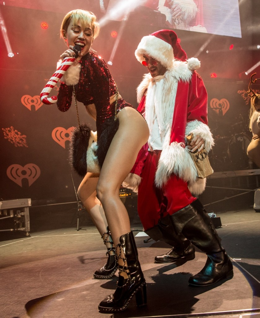 Miley Cyrus twerking Santa during KIIS FM's Jingle Ball 2013. Christopher Polk/Getty Images for Clear Channel