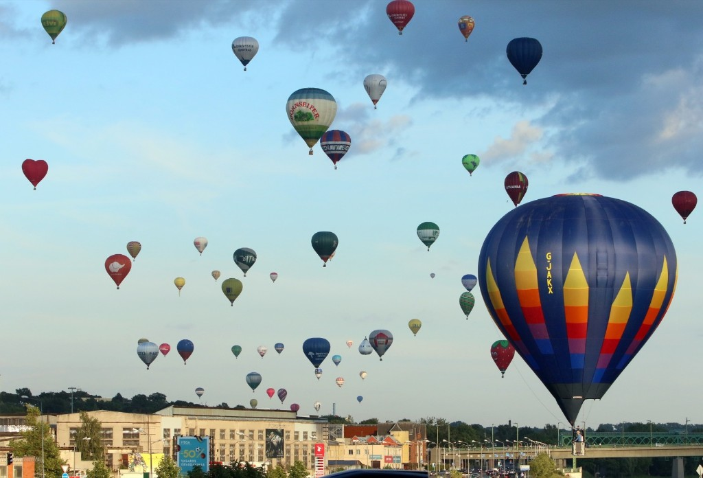 One hundred hot air balloons float into the skies over Kaunas, Lithuania. PETRAS MALUKAS/AFP/Getty Images