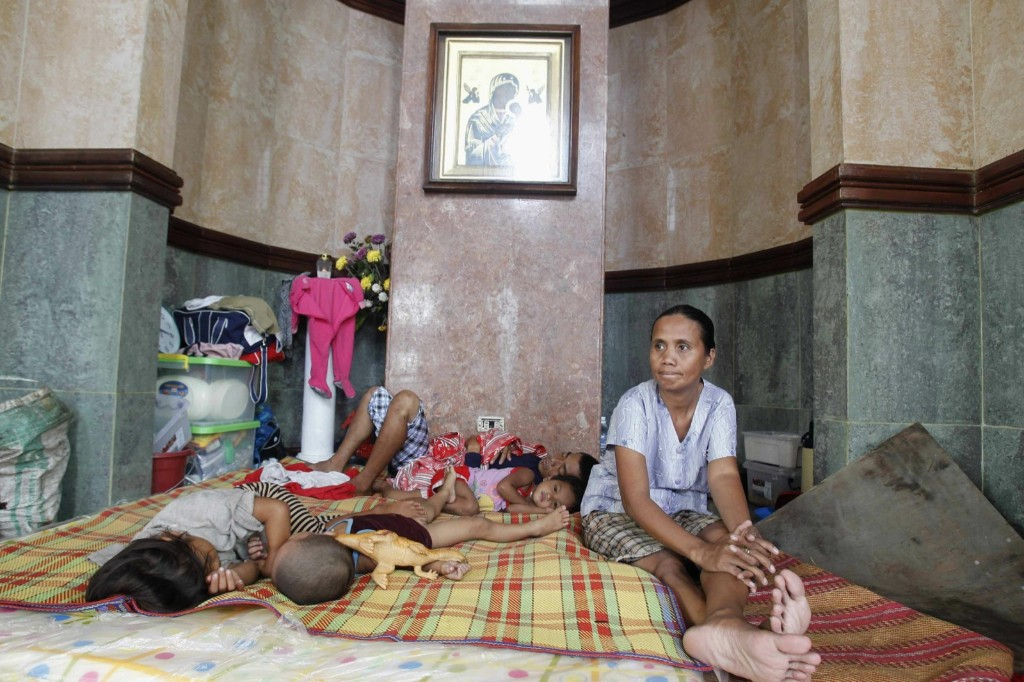 A family rests inside a Catholic church in Tacloban. REUTERS/Romeo Ranoco