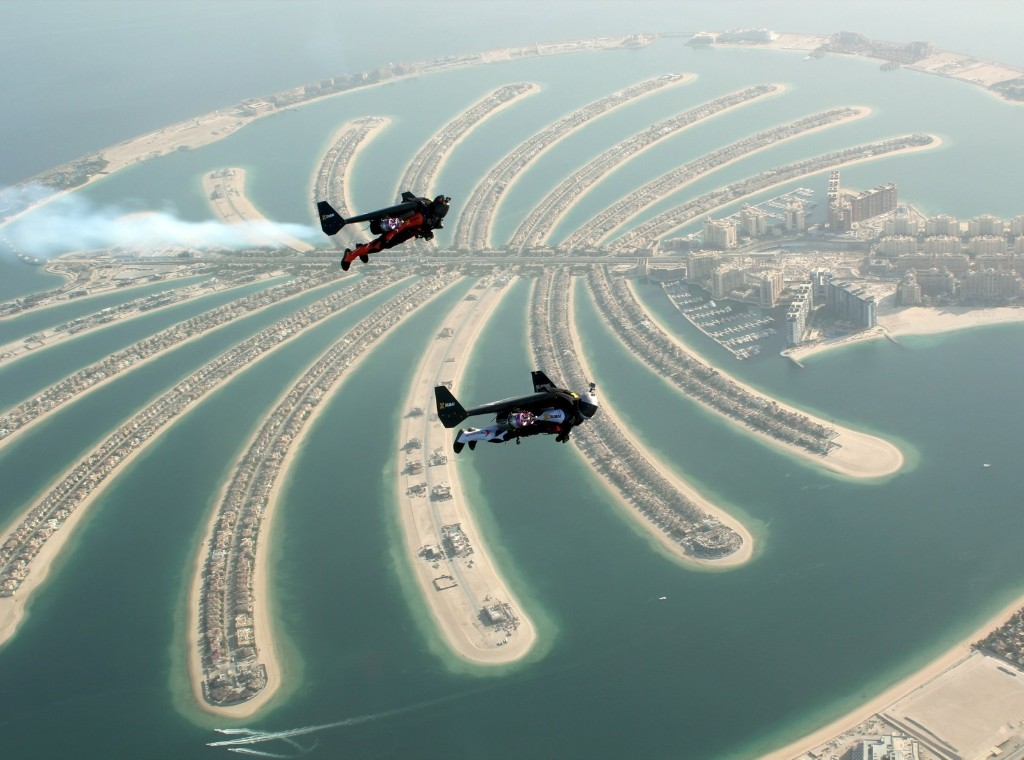 A view from a sea plane shows Swiss pilot and original Jetman Yves Rossy and Vince Reffett flying over Dubai's Palm Island. REUTERS/Lara Sukhtian