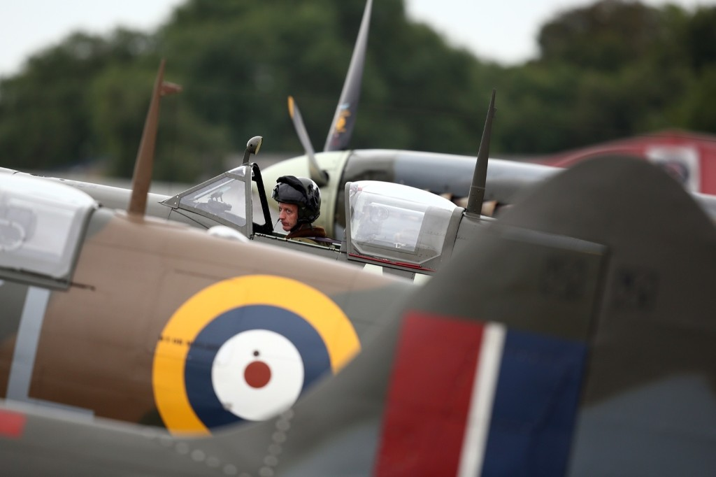 A pilot prepares to take off in a Spitfire, Tuesday, in Biggin Hill, England. Carl Court/Getty Images