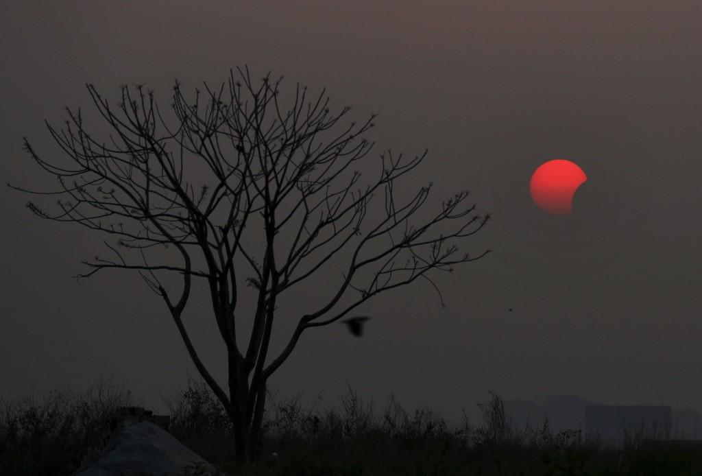 A partial solar eclipse in Dhaka, Bangladesh. AP Photo/A.M. Ahad