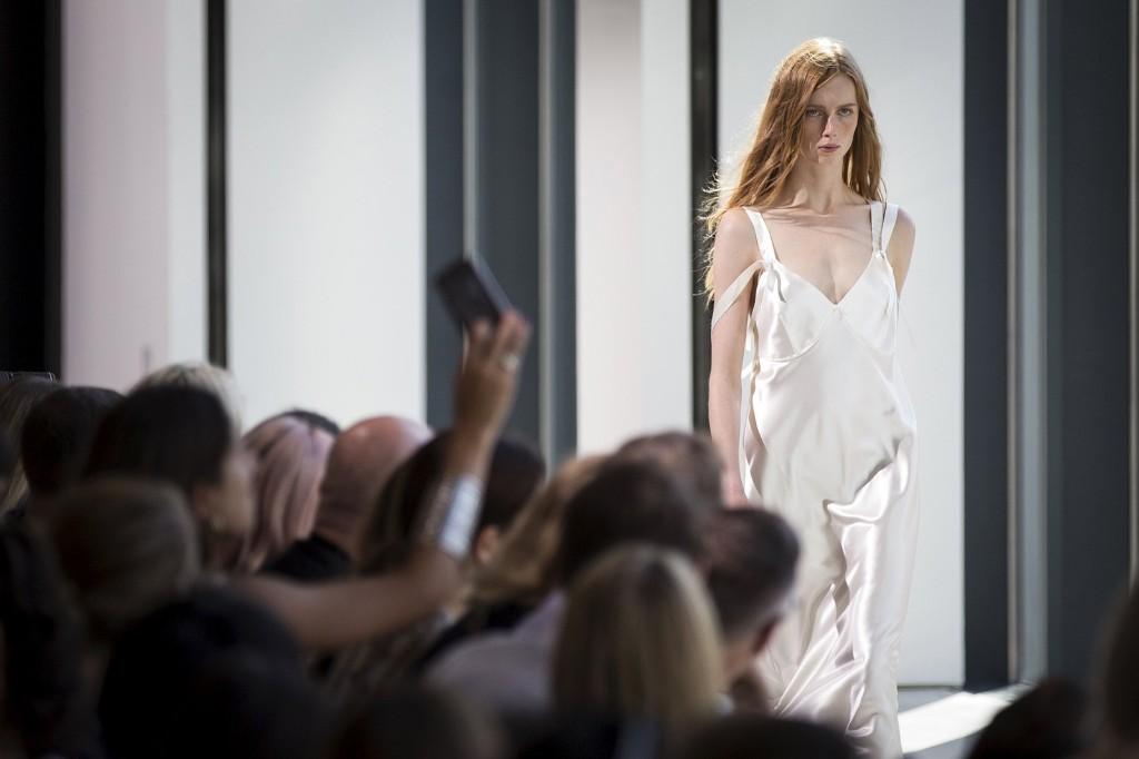 A model presents a creation during the Calvin Klein Spring/Summer 2016 collection. REUTERS/Carlo Allegri
