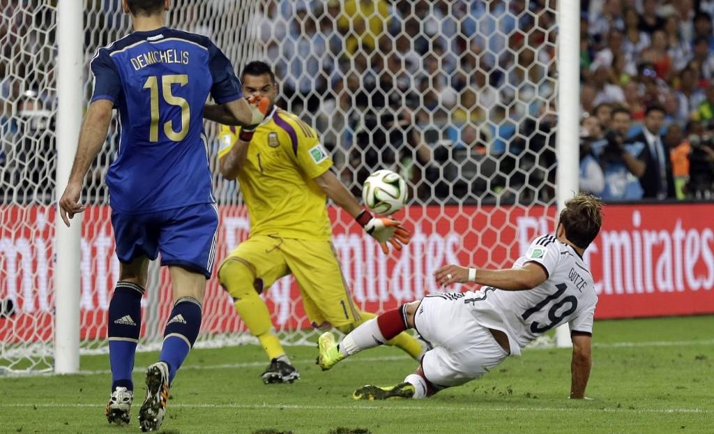 Germany's Mario Goetze scores the winning goal past Argentina's goalkeeper Sergio Romero. AP Photo/Victor R. Caivano