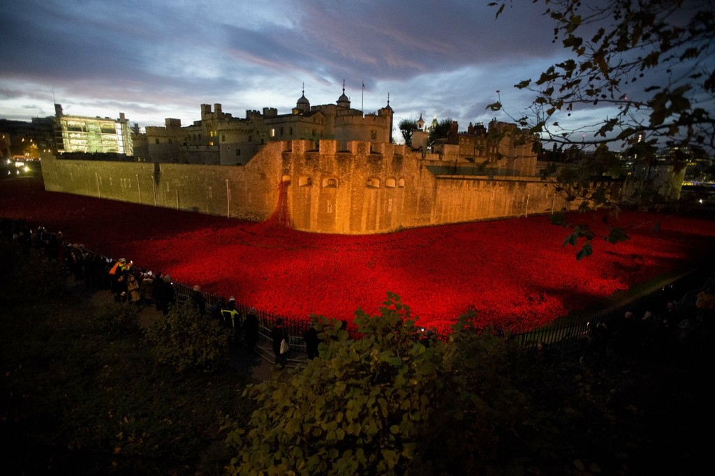 The ceramic poppy art installation by artist Paul Cummins entitled 'Blood Swept Lands and Seas of Red' at the Tower of London. AP Photo/Matt Dunham