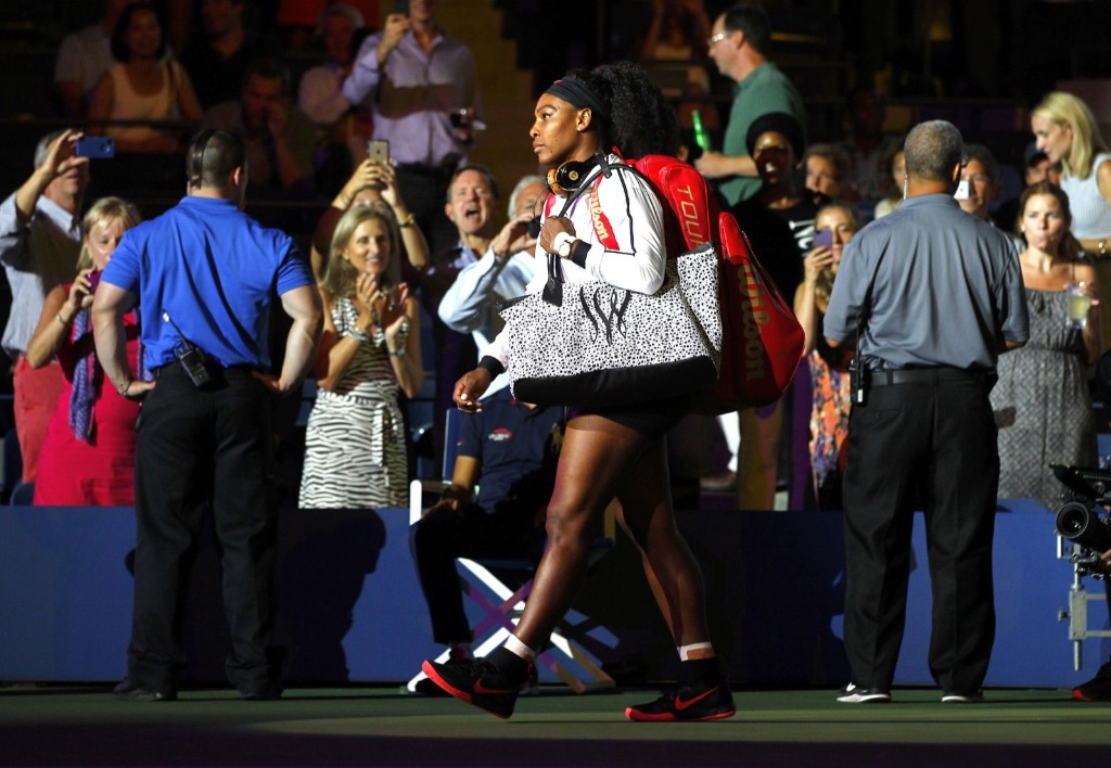 Serena Williams of the U.S. arrives for her match against her sister Venus Williams at the U.S. Open tennis tournament in New York, Tuesday. Gary Hershorn/Corbis