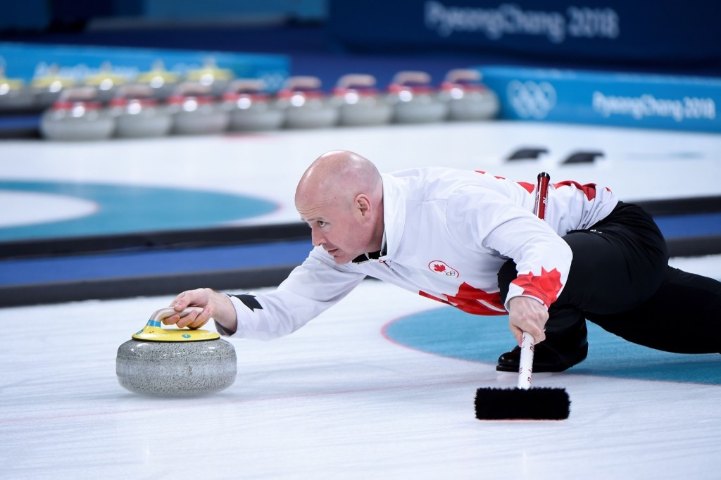 Canada's Kevin Koe throws the stone during the curling bronze medal game. WANG ZHAO/AFP/Getty Images