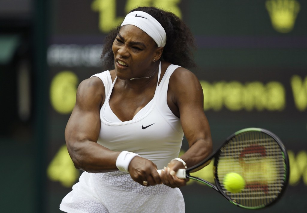 Serena Williams makes a return to Venus Williams during her 6-4, 6-3 victory over her sister at Wimbledon. AP Photo/Alastair Grant