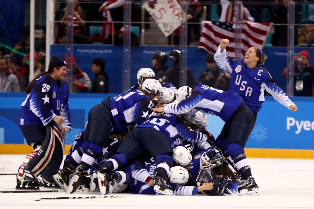 U.S. women's hockey team celebrates after defeating Canada in a shootout to win the the gold medal. Jamie Squire/Getty Images