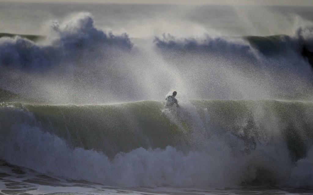 A bodyboarder rides a wave in Nazare, Portugal. REUTERS/Rafael Marchante