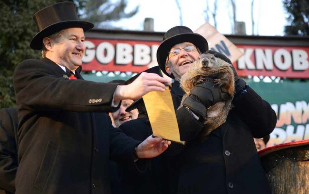 Groundhog Club Vice President Jeff Lundy (L), shares Phil's prediction with co-handler Ron Ploucha. REUTERS/Alan Freed