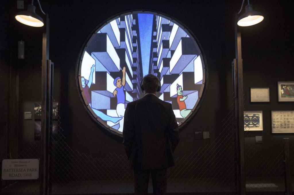 A man listens to an audio display at the Pink Floyd exhibition 'Their Mortal Remains'. Joel Ryan/Invision/AP