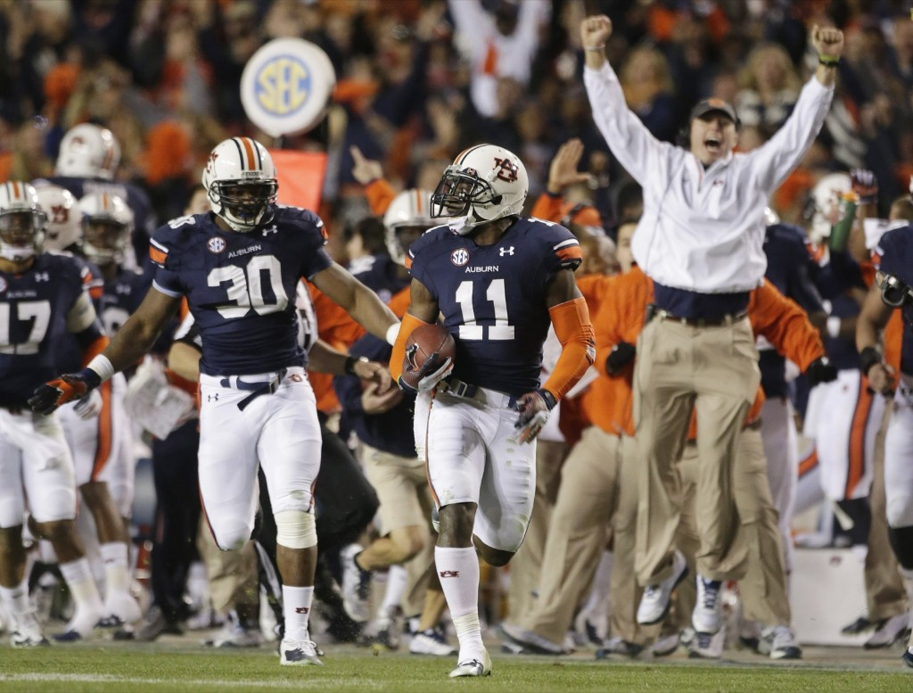 In one of the most incredible endings in college football history, Chris Davis of Auburn returns a missed field-goal attempt 109 yards to score the game-winning touchdown as time expired in the fourth quarter against No. 1 Alabama. AP Photo/Dave Martin