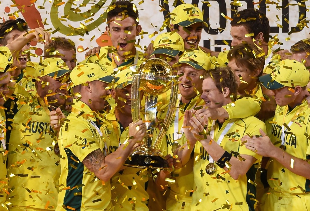 Australian captain Michael Clarke holds the trophy with his teammates as they celebrate their seven wicket win over New Zealand in the Cricket World Cup final in Melbourne, Australia, Sunday. AP Photo/Andy Brownbill