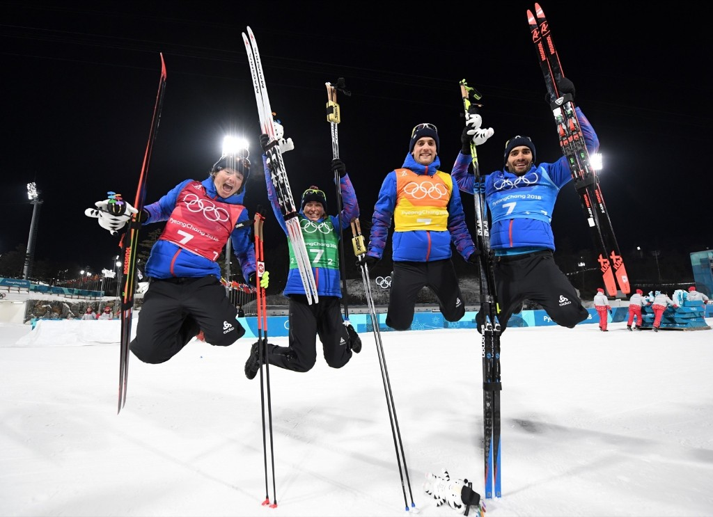 Gold medalists Marie Dorin Habert, Anais Bescond, Simon Desthieux and Martin Fourcade of France celebrate victory in the mixed relay biathlon event. FRANCK FIFE/AFP/Getty Images