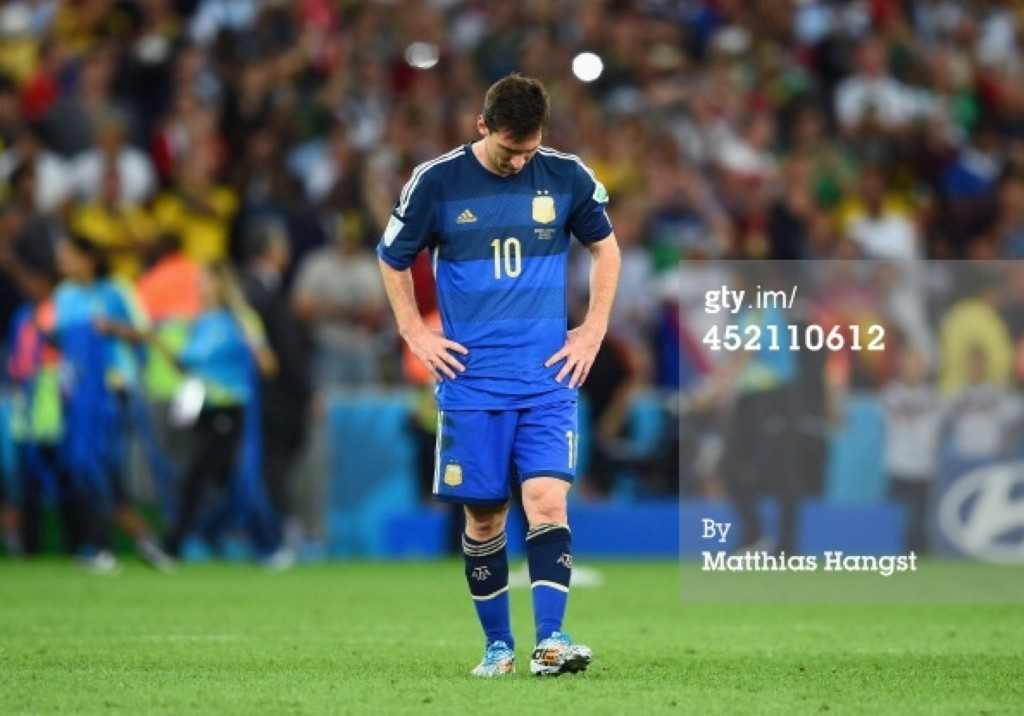 A dejected Lionel Messi leaves the pitch after being defeated by Germany 1-0 in extra time. Matthias Hangst/Getty Images