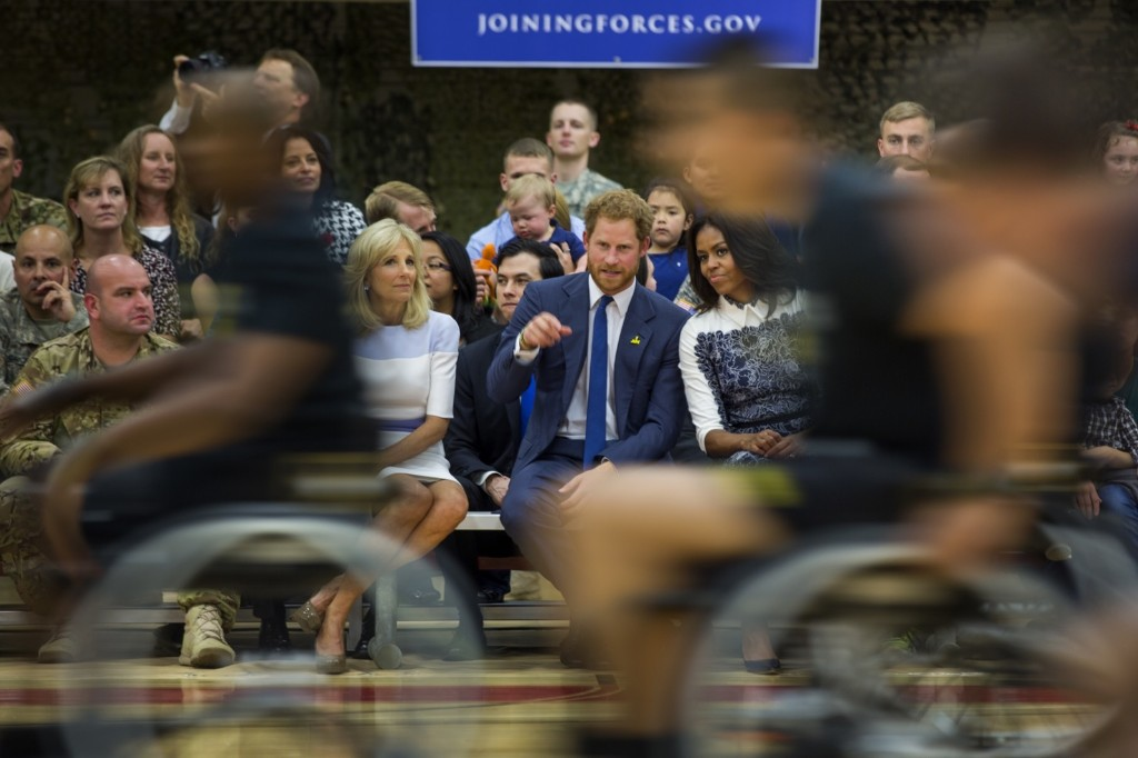 Prince Harry of Wales, First Lady Michelle Obama and Dr. Jill Biden watch wounded American veterans play basketball at an event to promote the 2016 Invictus Games at Fort Belvoir, Va. EPA/JIM LO SCALZO
