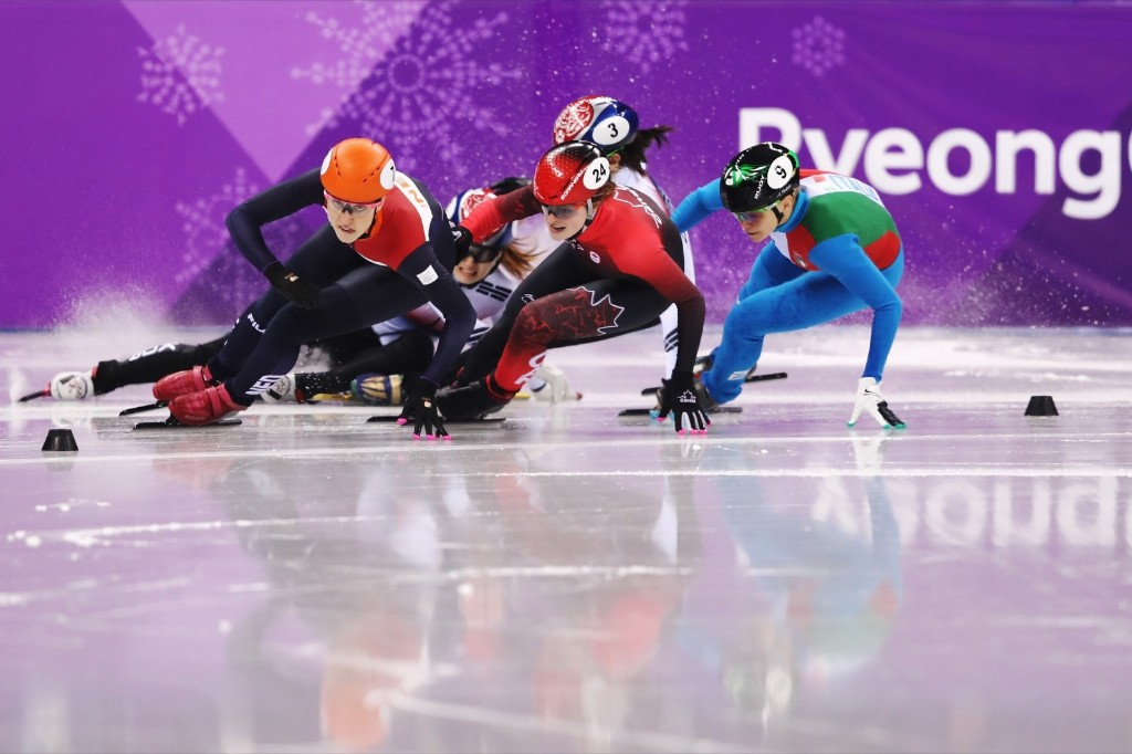 Suzanne Schulting of the Netherlands leads as Sukhee Shim and Minjeong Choi of Korea crash during the 1000m short track speed skating final. Richard Heathcote/Getty Images