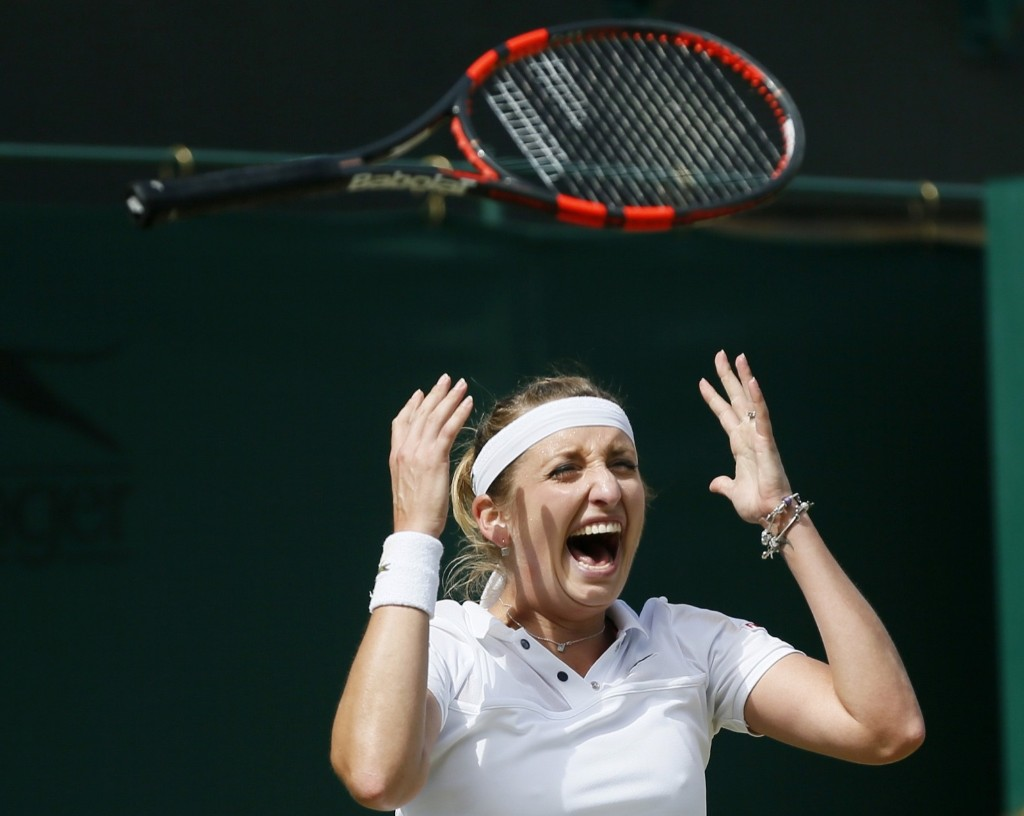 Timea Bacsinszky of Switzerland celebrates after winning her match against Monica Niculescu. REUTERS/Stefan Wermuth