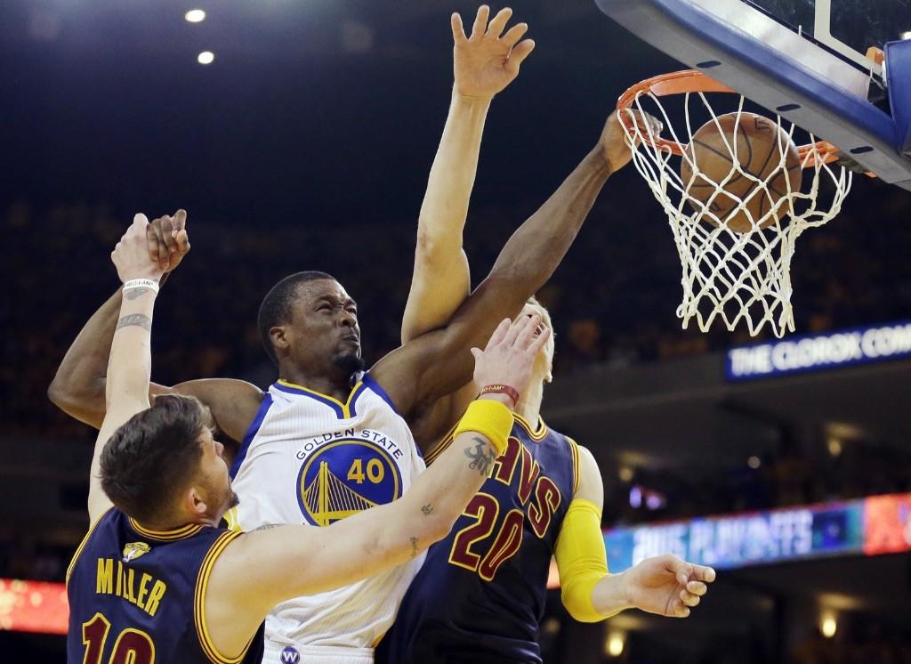 Warriors forward Harrison Barnes dunks over Cavaliers Mike Miller, left, and center Timofey Mozgov. AP Photo/Ben Margot
