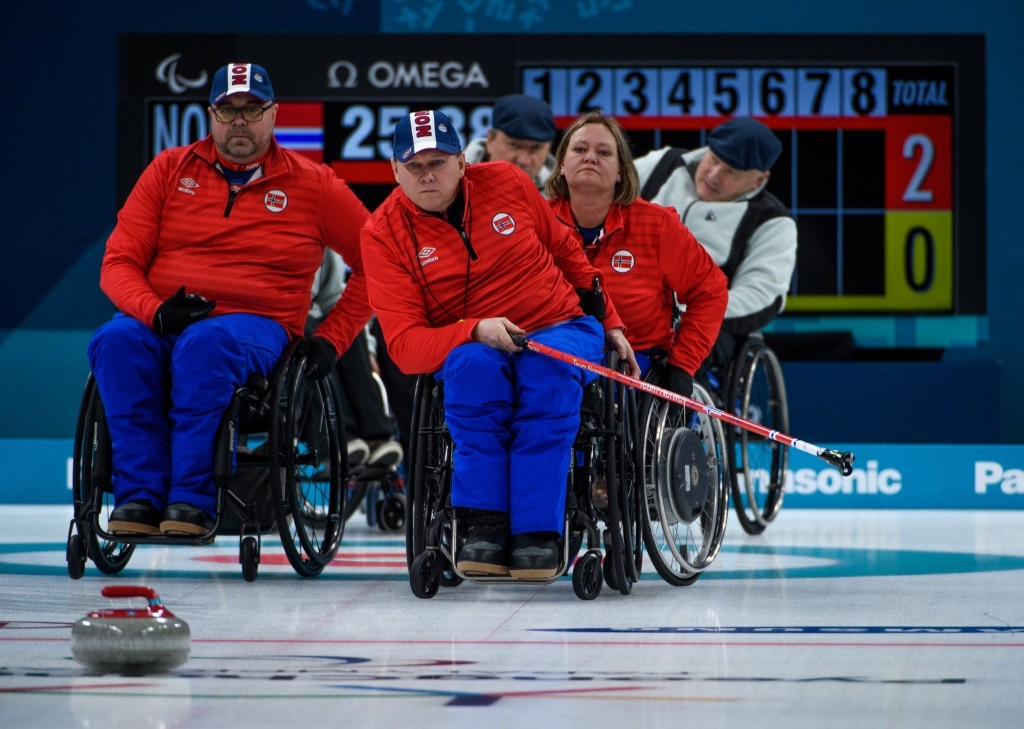 Rune Lorentsen of Norway after throwing a stone during the Wheelchair Curling Round Robin Session. Thomas Lovelock for OIS/IOC